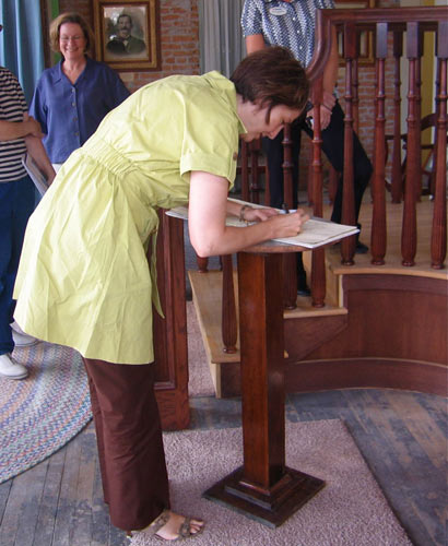 Cathy Rodgers-McMorris signs guest book in Harrington Opera House lobby