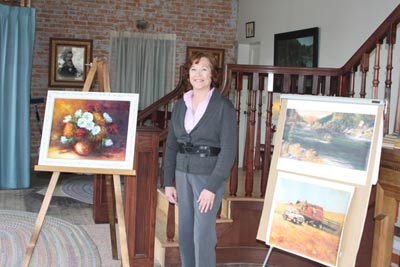 Deb Hendrickson posing with Charlotte Schacher Paintings