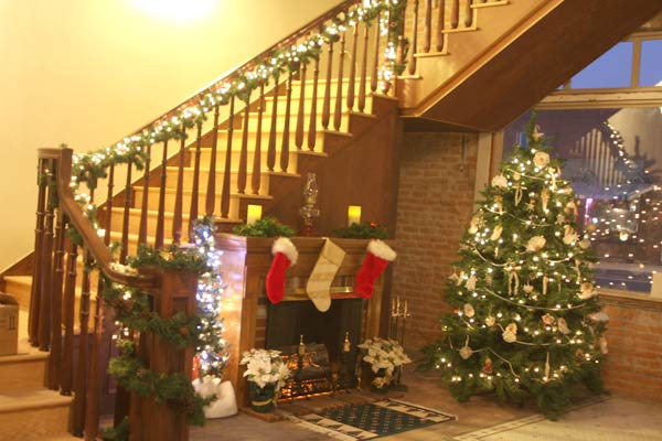 HOHS stairway from lobby deorated for Christmas